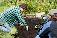 Callan planting onions, on camera with Giovanni Lorusso (Cinematographer).