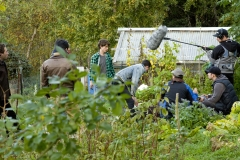 Preparing to film Callan at work in his veggie patch (Callan, Nicholas Denton, in the green and black chequered shirt).